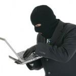 Computer criminal - Hacker with laptop computer